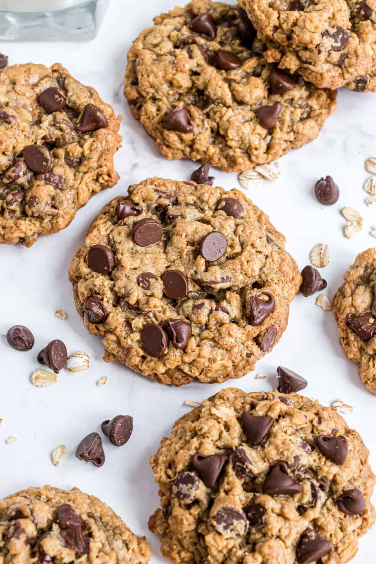 Oatmeal chocolate chip cookies on parchment paper.