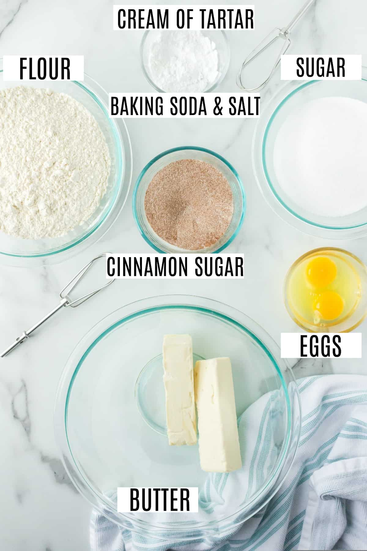 Ingredients needed to make snickerdoodles on a marble counter top.