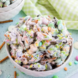 Bunny chow candy in a bowl with pastel sprinkles.
