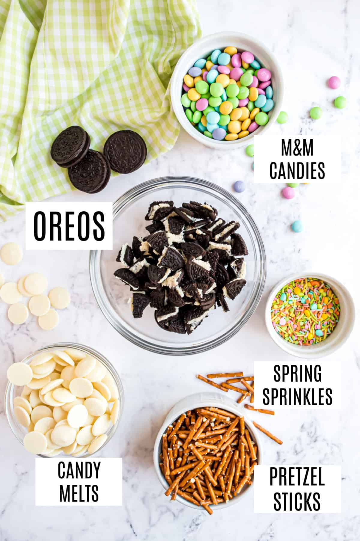 Ingredients needed for bunny chow candy, including Oreos and pretzels.