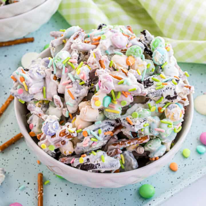 An Easter dessert the kids can help make! Bunny Chow Candy will brighten up your spring with sweet crunchy taste that no one can resist. This sweet and salty candy is packed with Oreos and holiday M&M's.