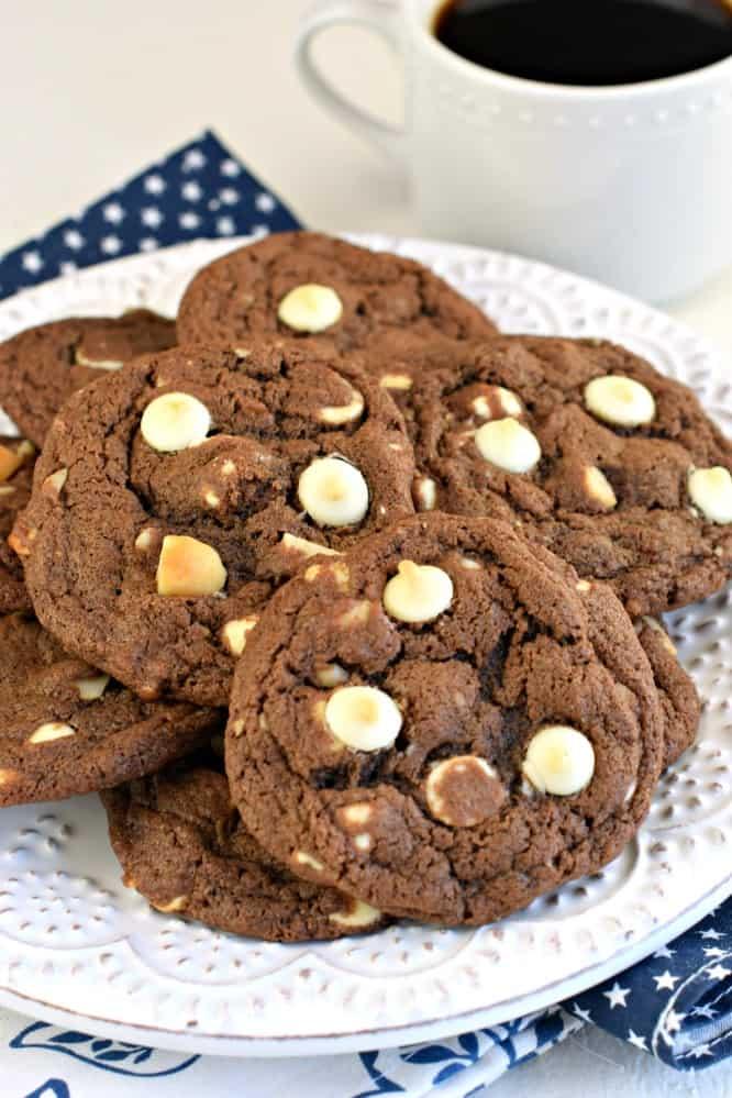 Chocolate macadamia nut cookies on a white plate.