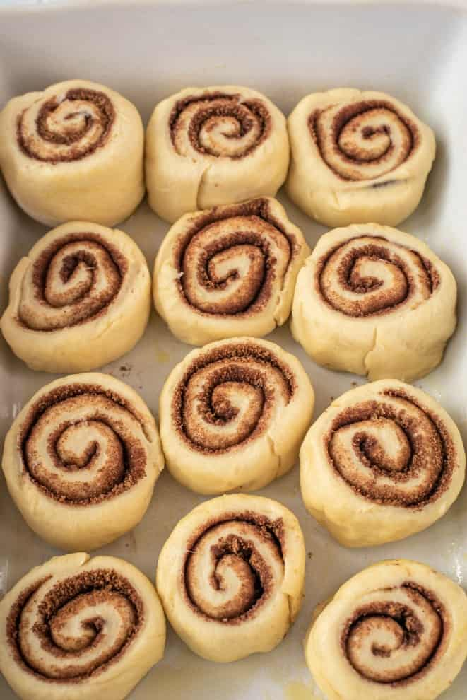 Pan of cinnamon rolls doubling in size before baking.