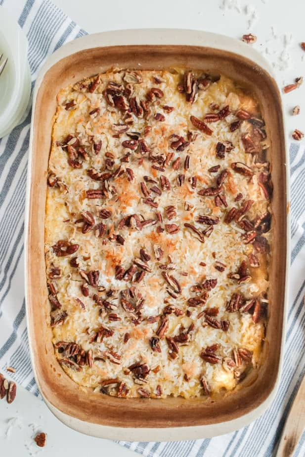 Baked peach dump cake in a 13x9-inch baking dish, topped with coconut and pecans.