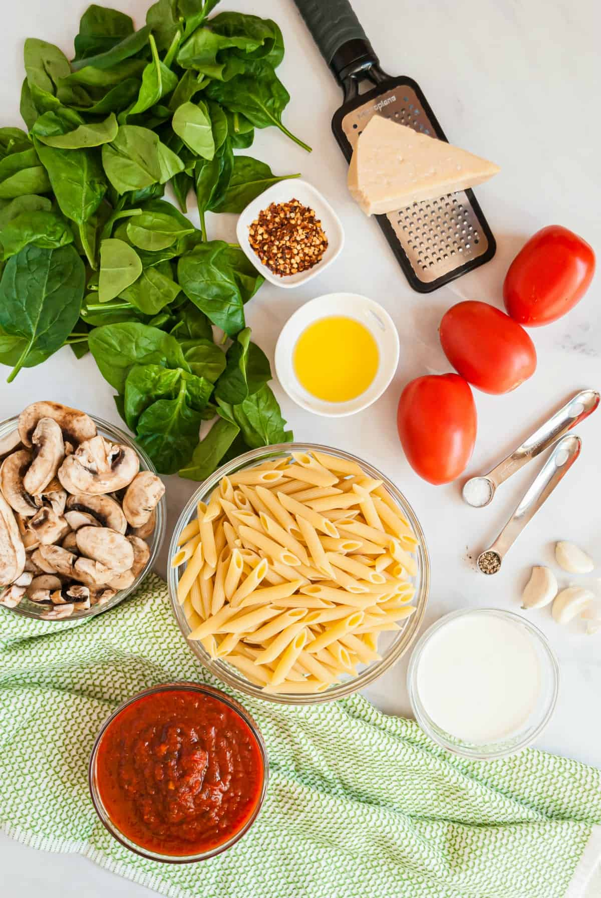 Picture of all the ingredients needed to make penne rosa.