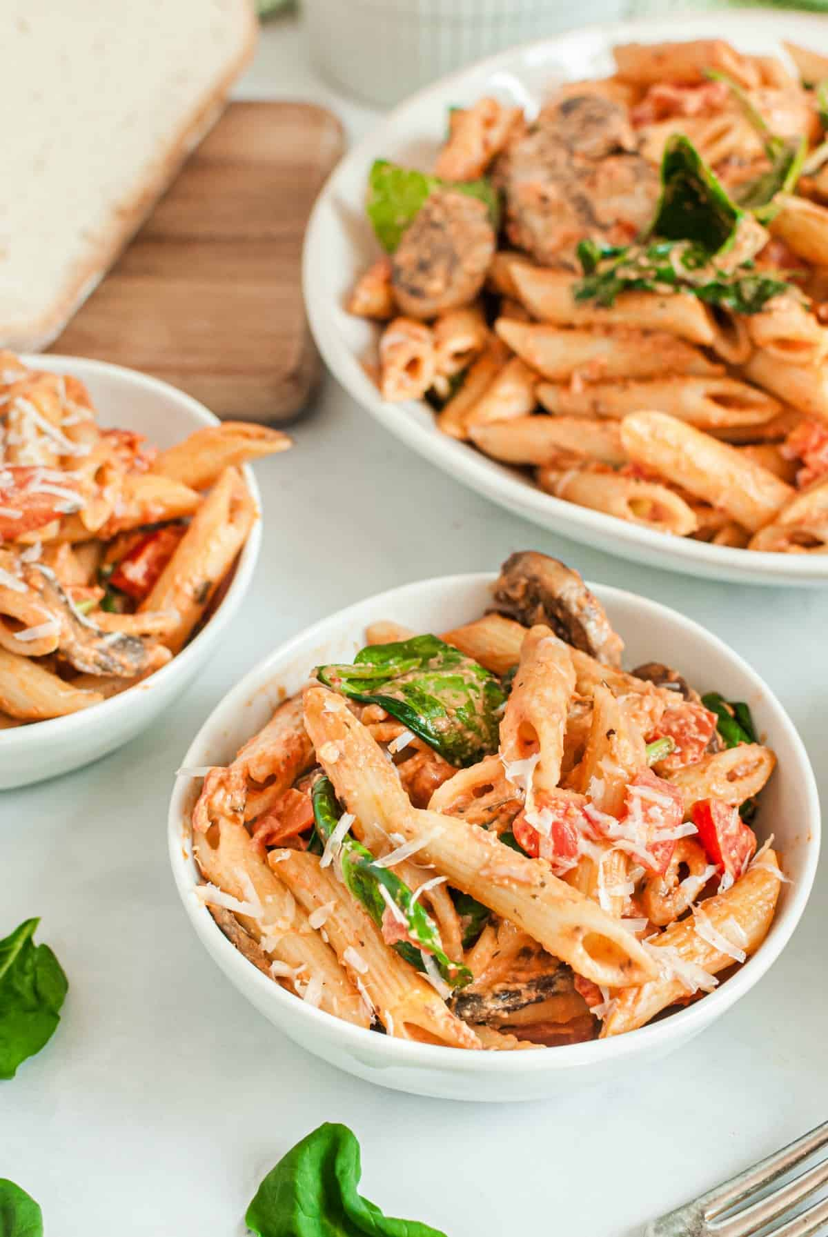 White bowls filled with homemade penne rosa.