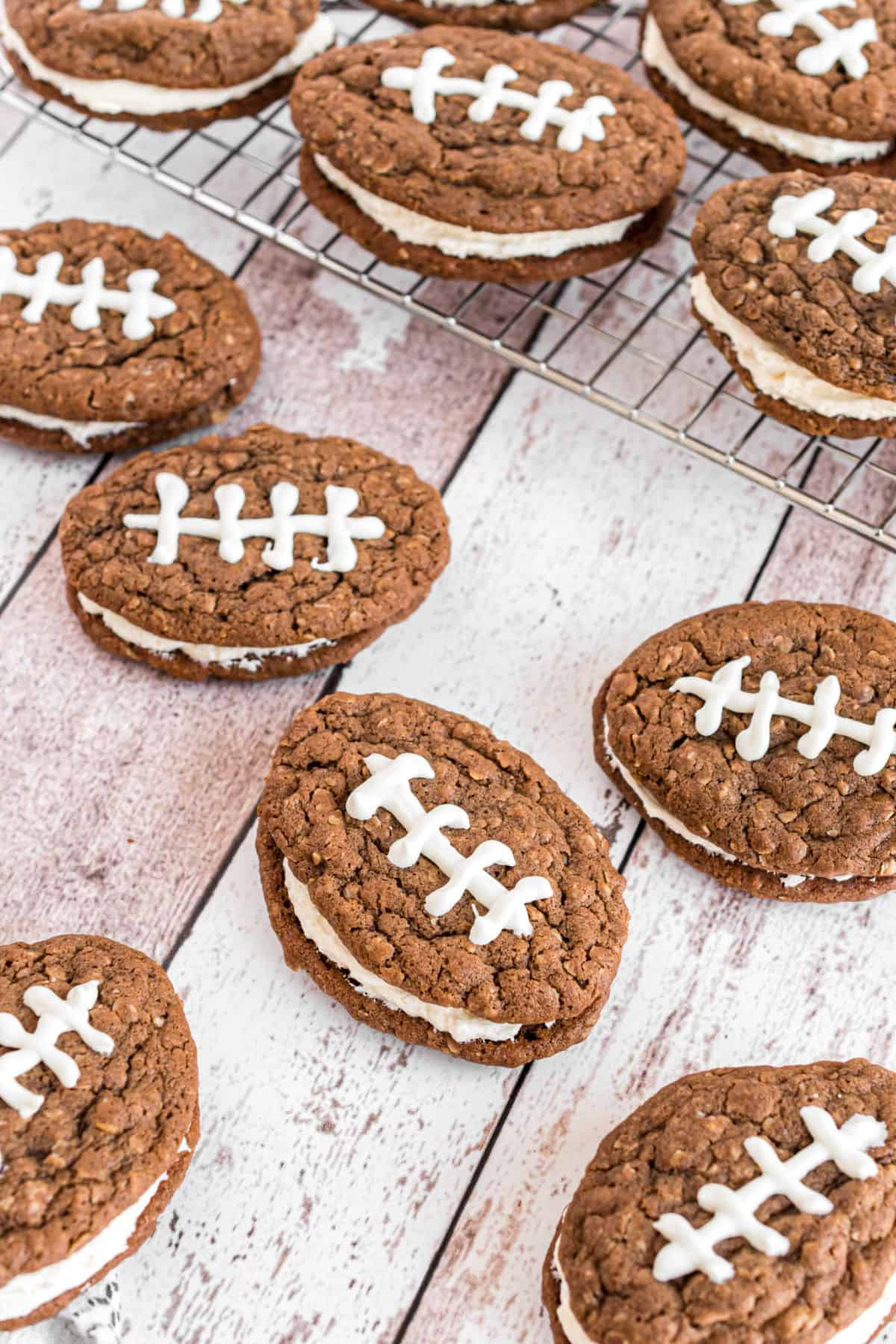 Little debbie homemade chocolate oatmeal cream pies with icing to resemble footballs.
