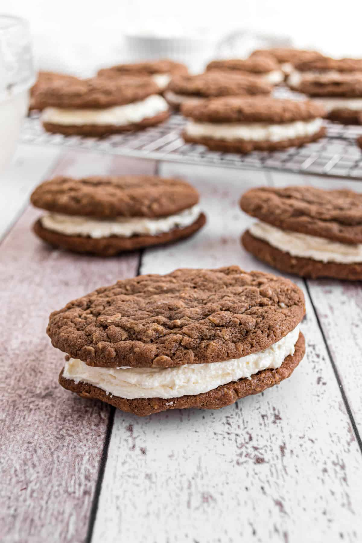 Chocolate oatmeal cream pie with filling on counter.