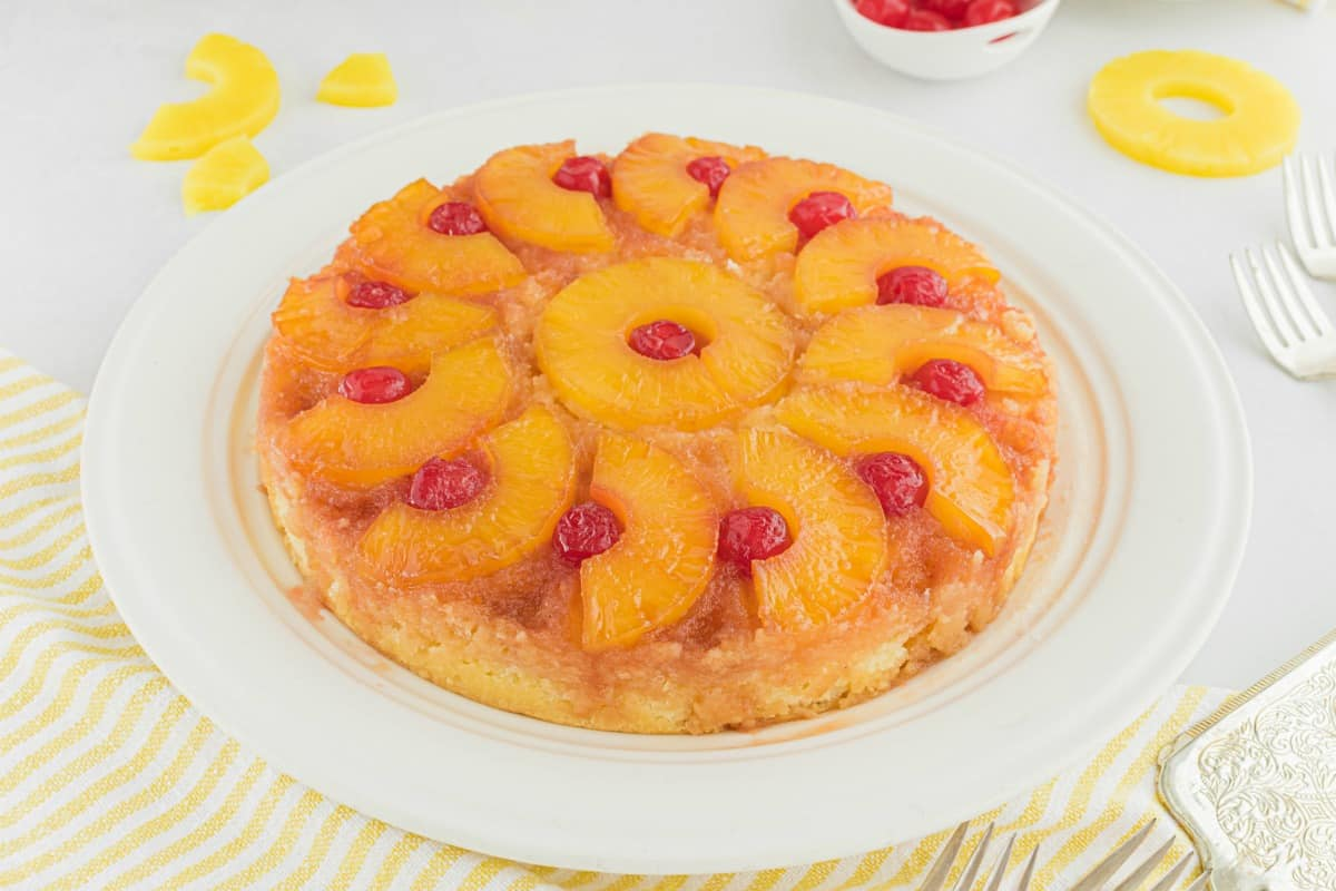 Pineapple Upside down cake served on a white cake platter.