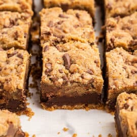 Toffee chocolate chip layered cookie bars cut into squares.