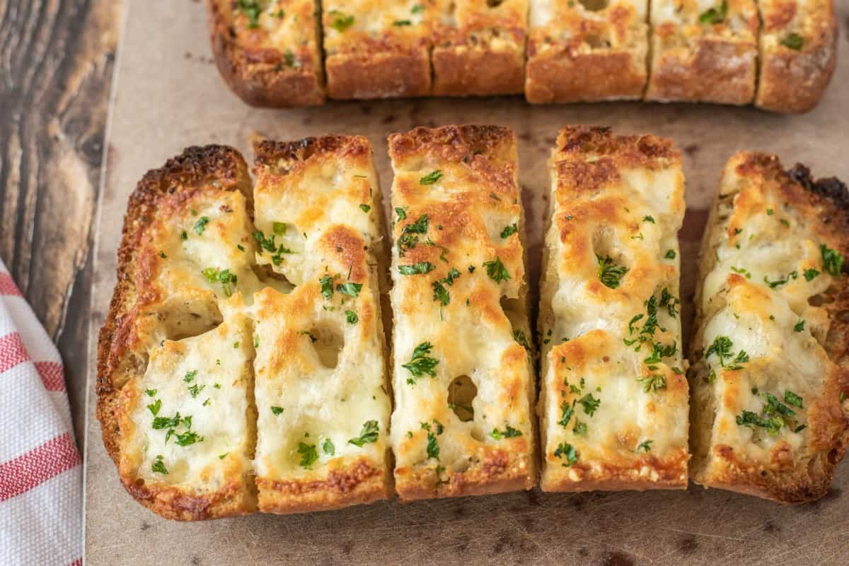 sliced garlic bread with cheese melted on top