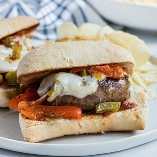 Sausage and peppers on french roll with melted provolone cheese.