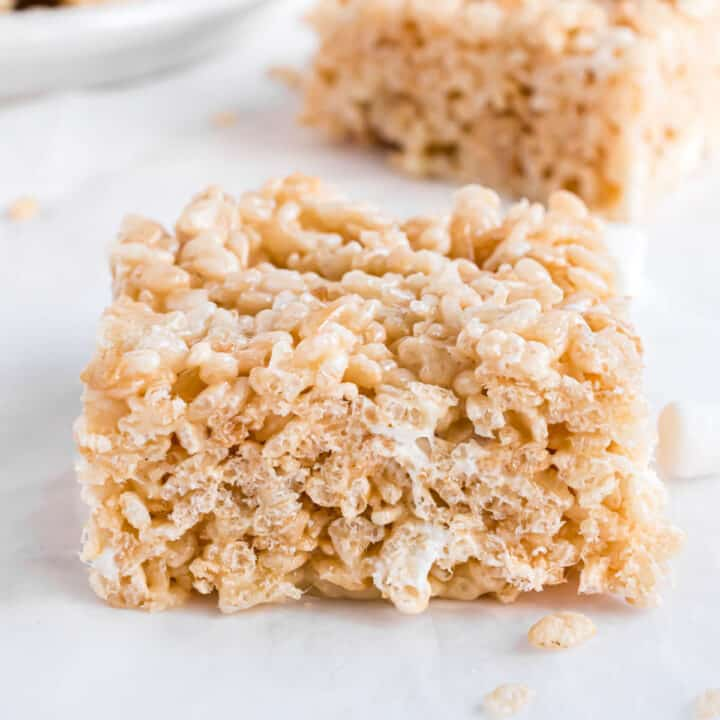 Thick and chewy rice krispie treat cut into a square.