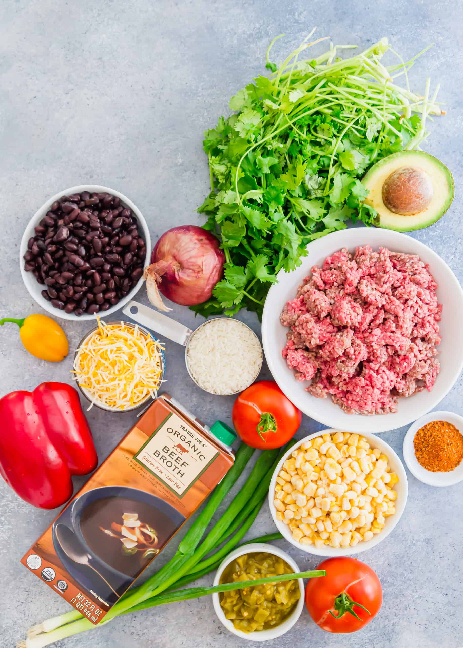 Ingredients needed for beef taco skillet, including ground beef, stock, beans, rice, and more.