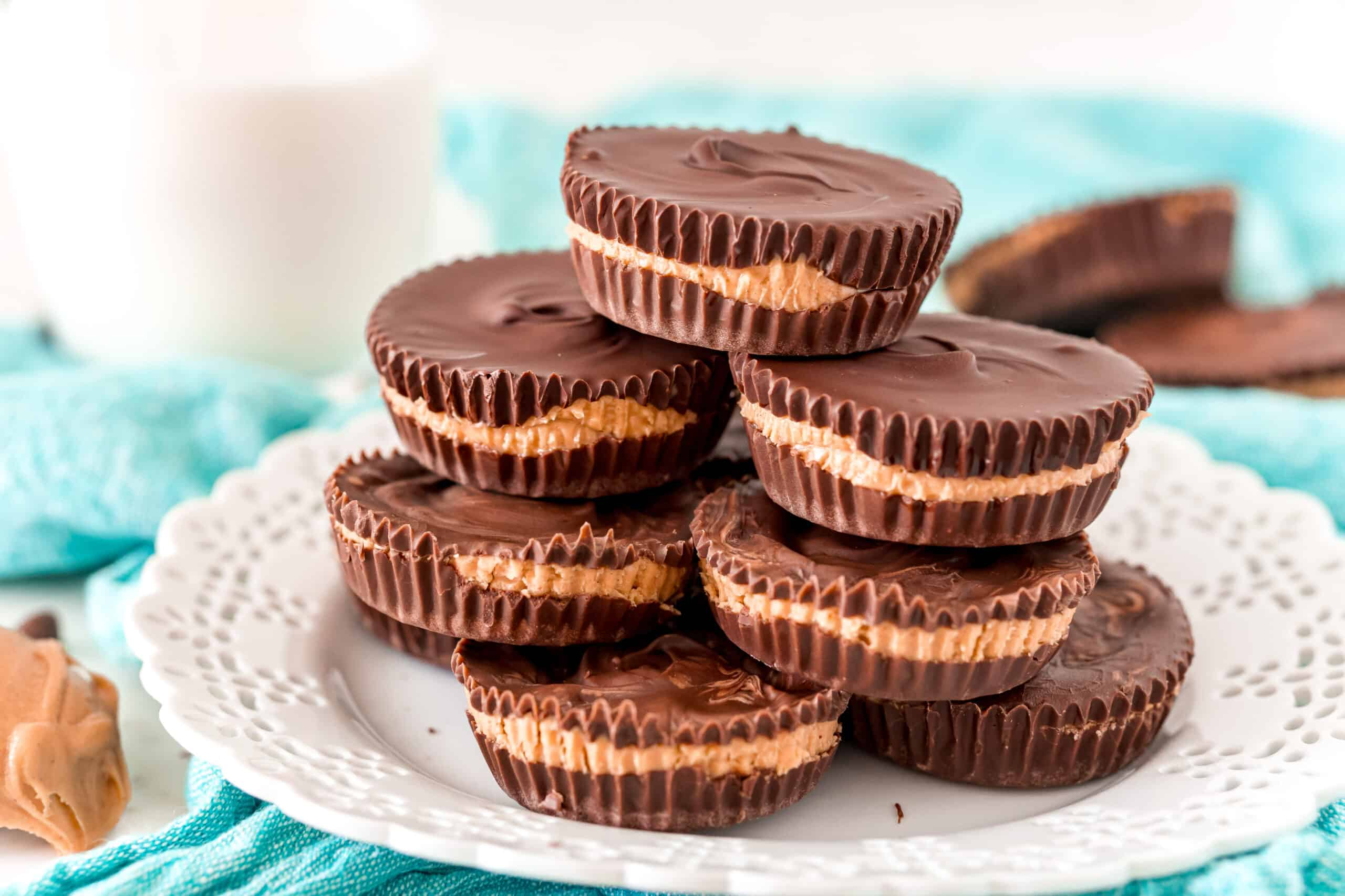 Stack of homemade peanut butter cups on a white plate.