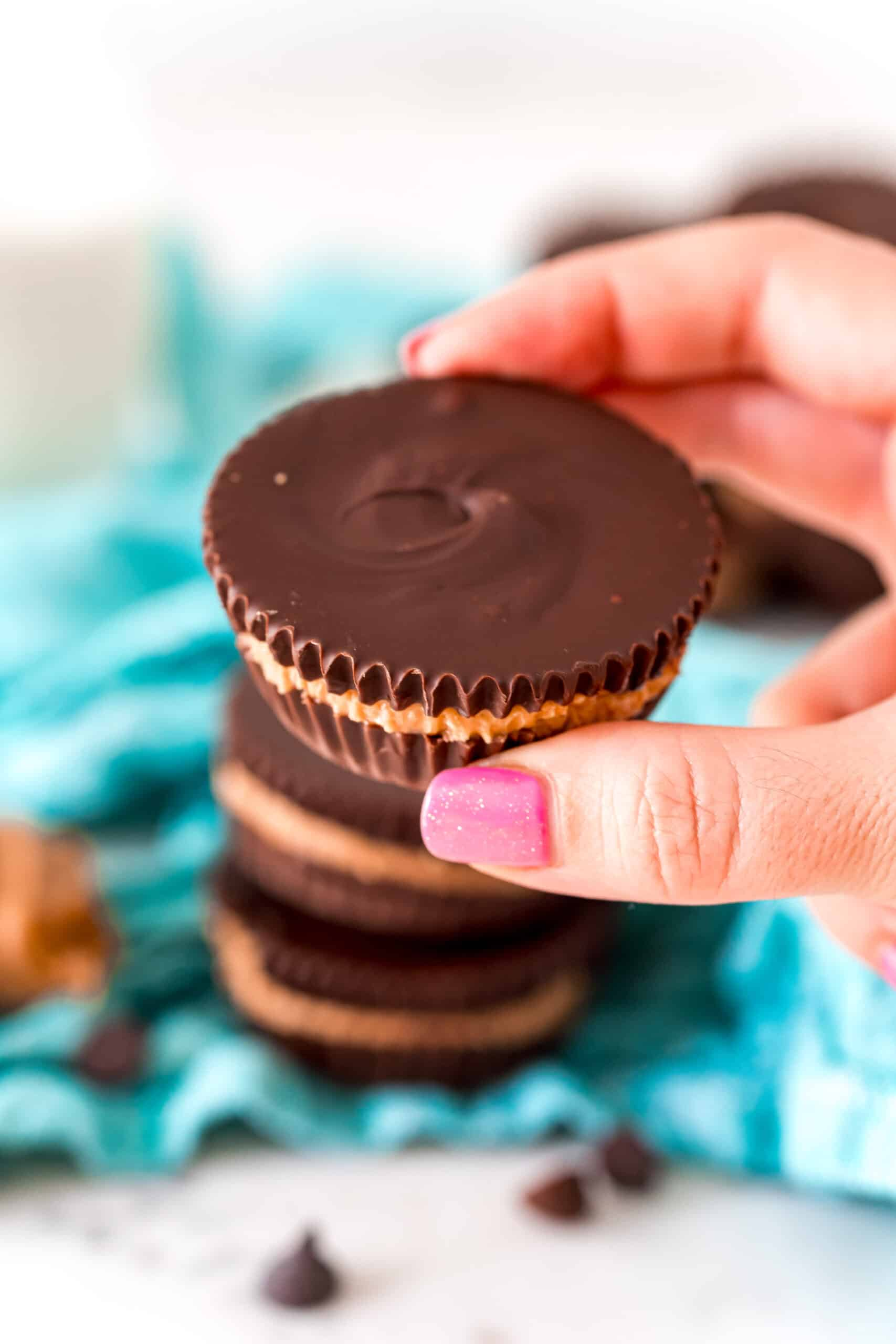 Homemade peanut butter cup being held.