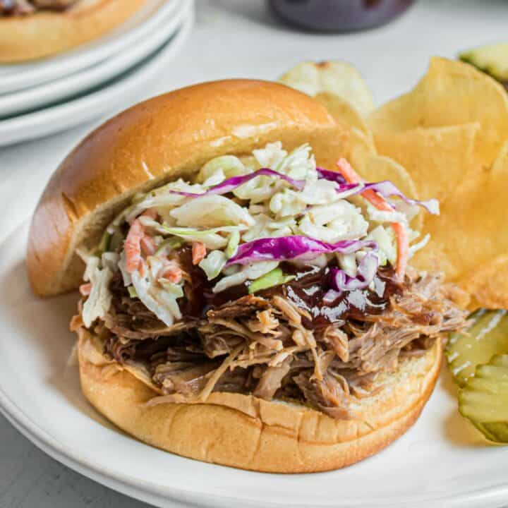 Instant Pot Hawaiian pulled pork on a bun with barbeque sauce and coleslaw.