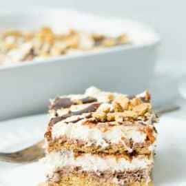 Slice of smores icebox cake on a white dessert plate.