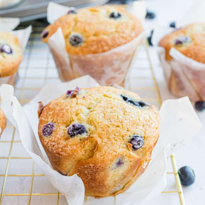 Blueberry muffins on wire cooling rack.