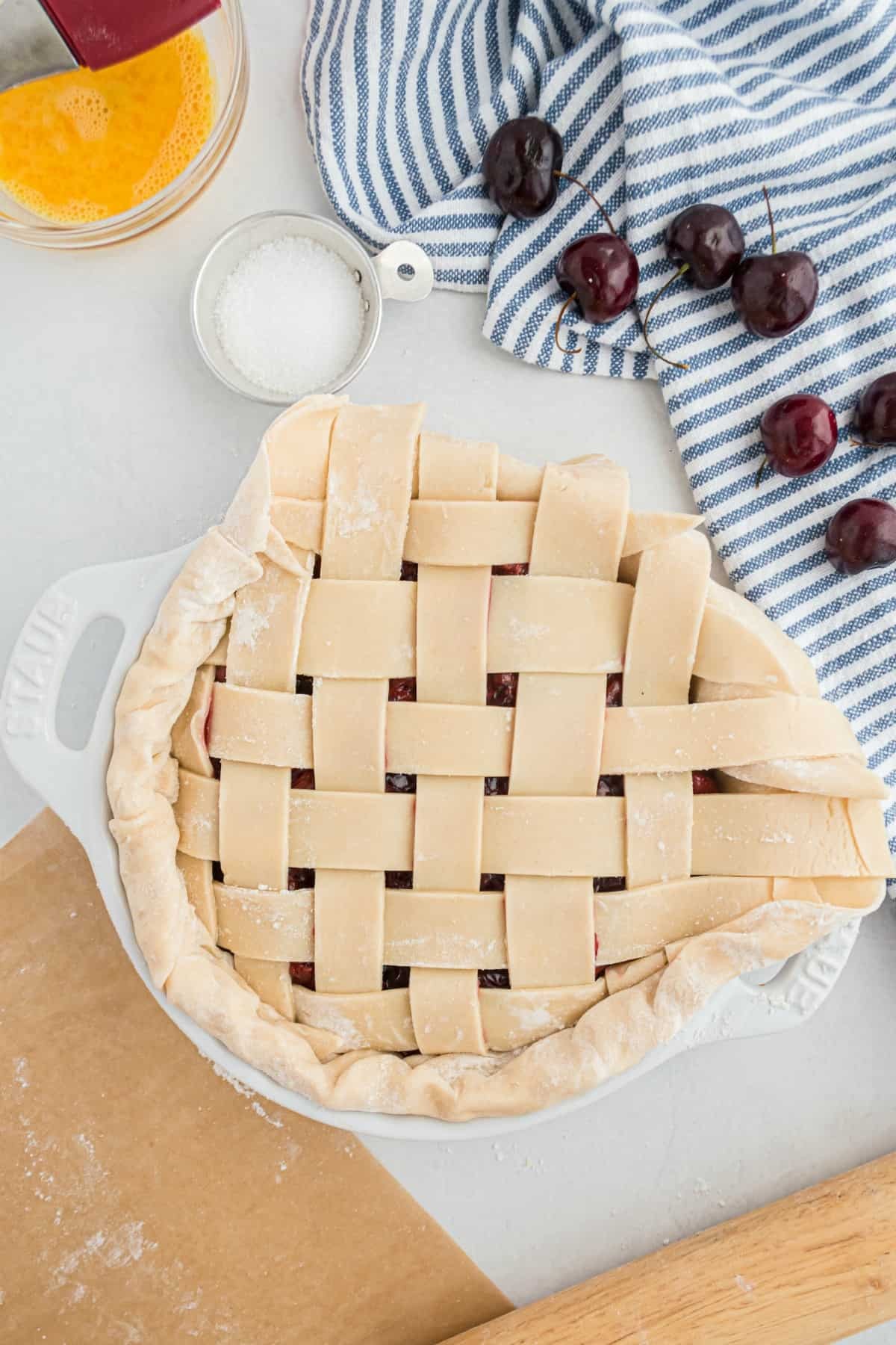 How to fold the edge of a lattice pie crust to make it even.