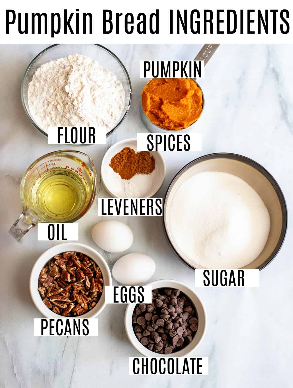 Ingredients needed for pumpkin bread including canned pumpkin, chocolate chips, and pecans.