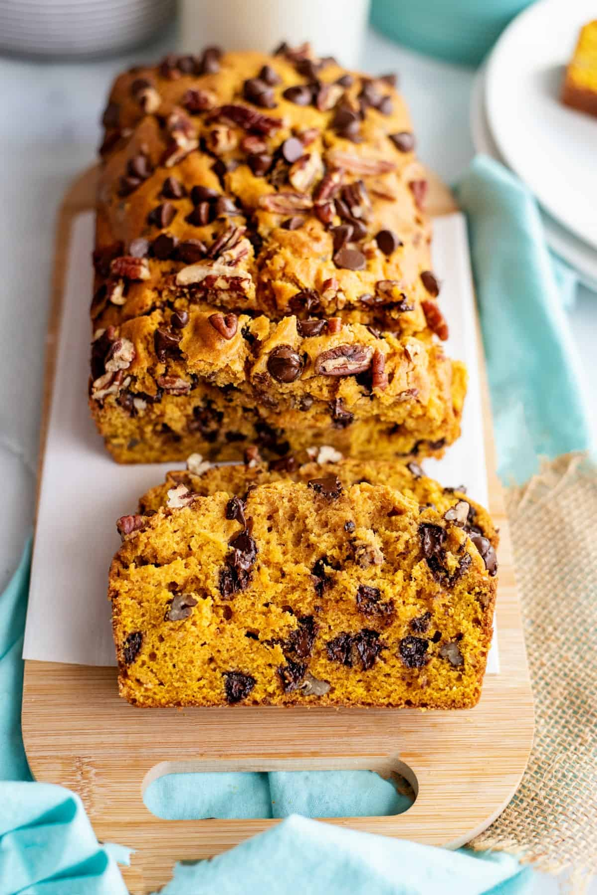 Sliced loaf of pumpkin bread with chocolate chips.