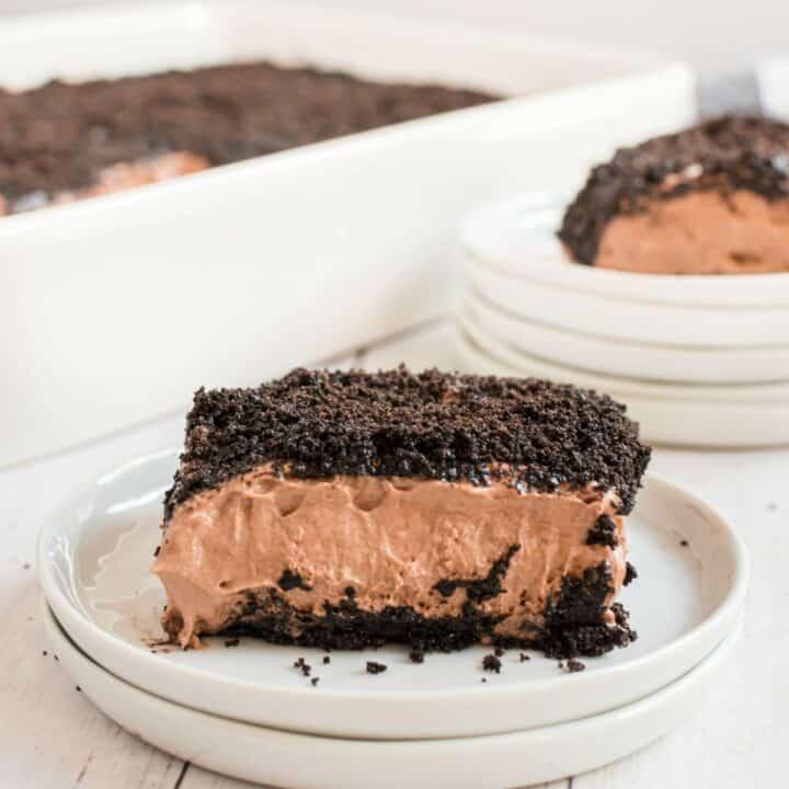 Chocolate dirt oreo cake slice on a white plate.