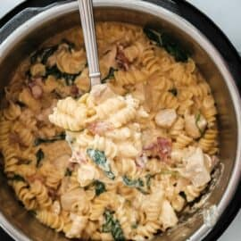 Crack chicken pasta being ladled out of a pressure cooker.