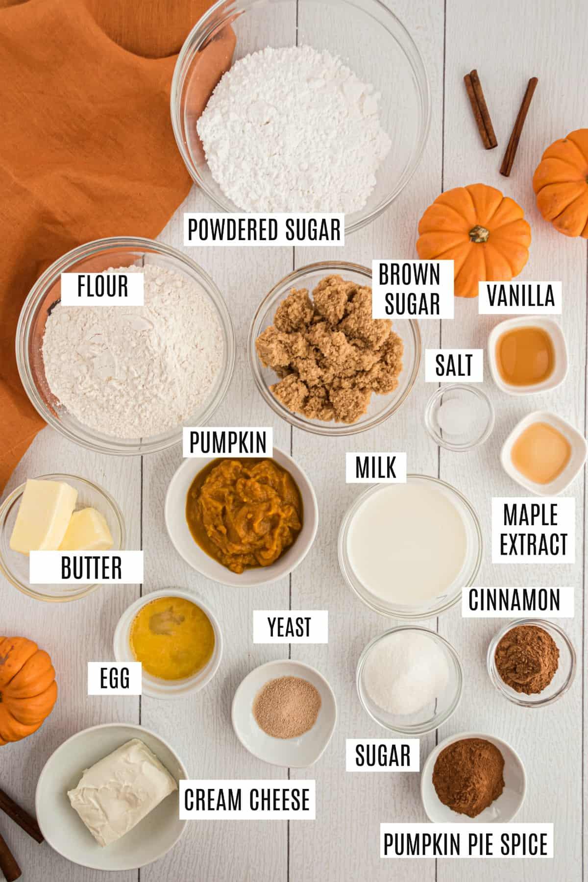 Ingredients needed to make pumpkin cinnamon rolls including yeast, pumpkin puree, and cinnamon.