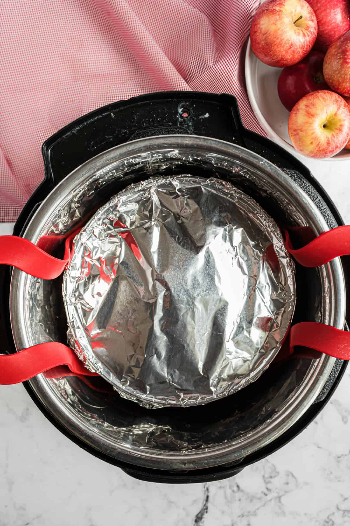 Foil covered dish in instant pot on a sling.