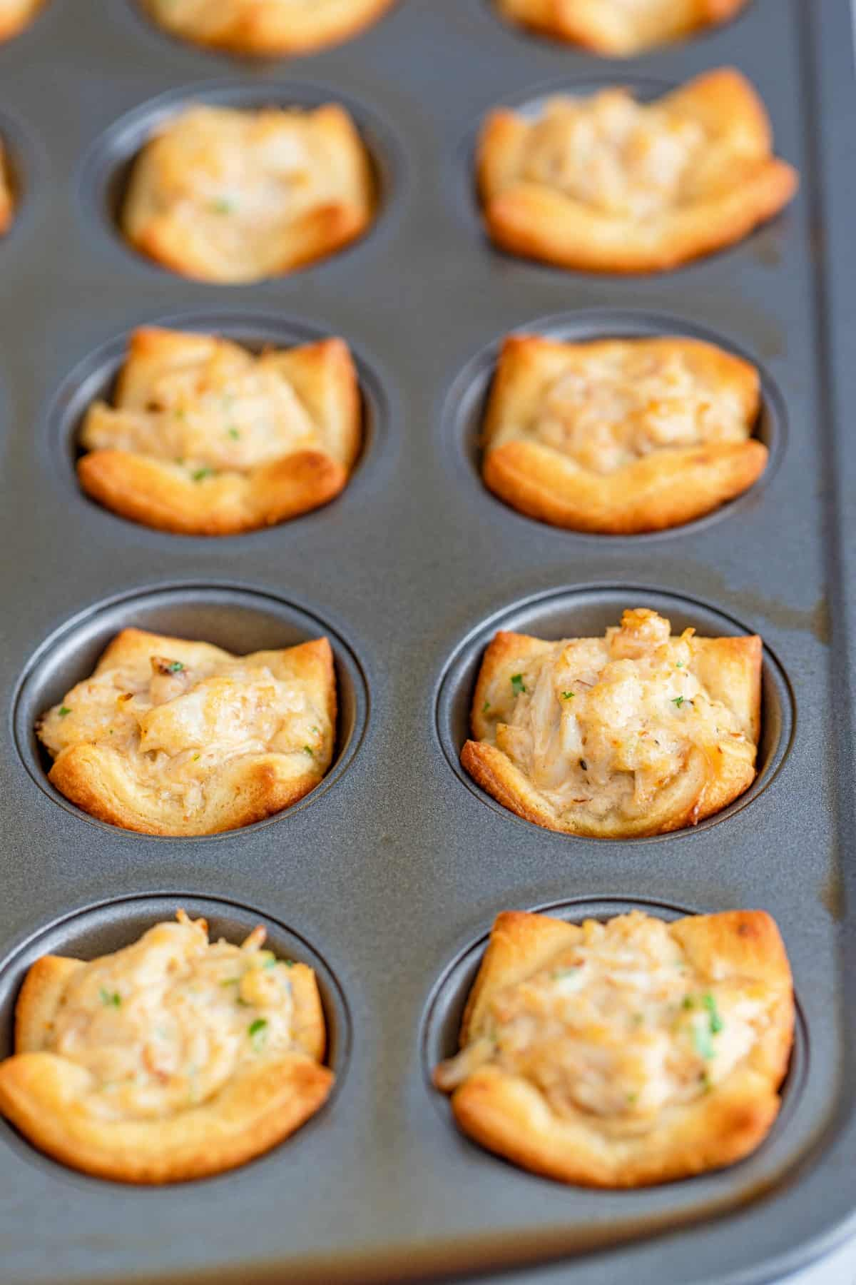 Crab puffs baked in a muffin tin.