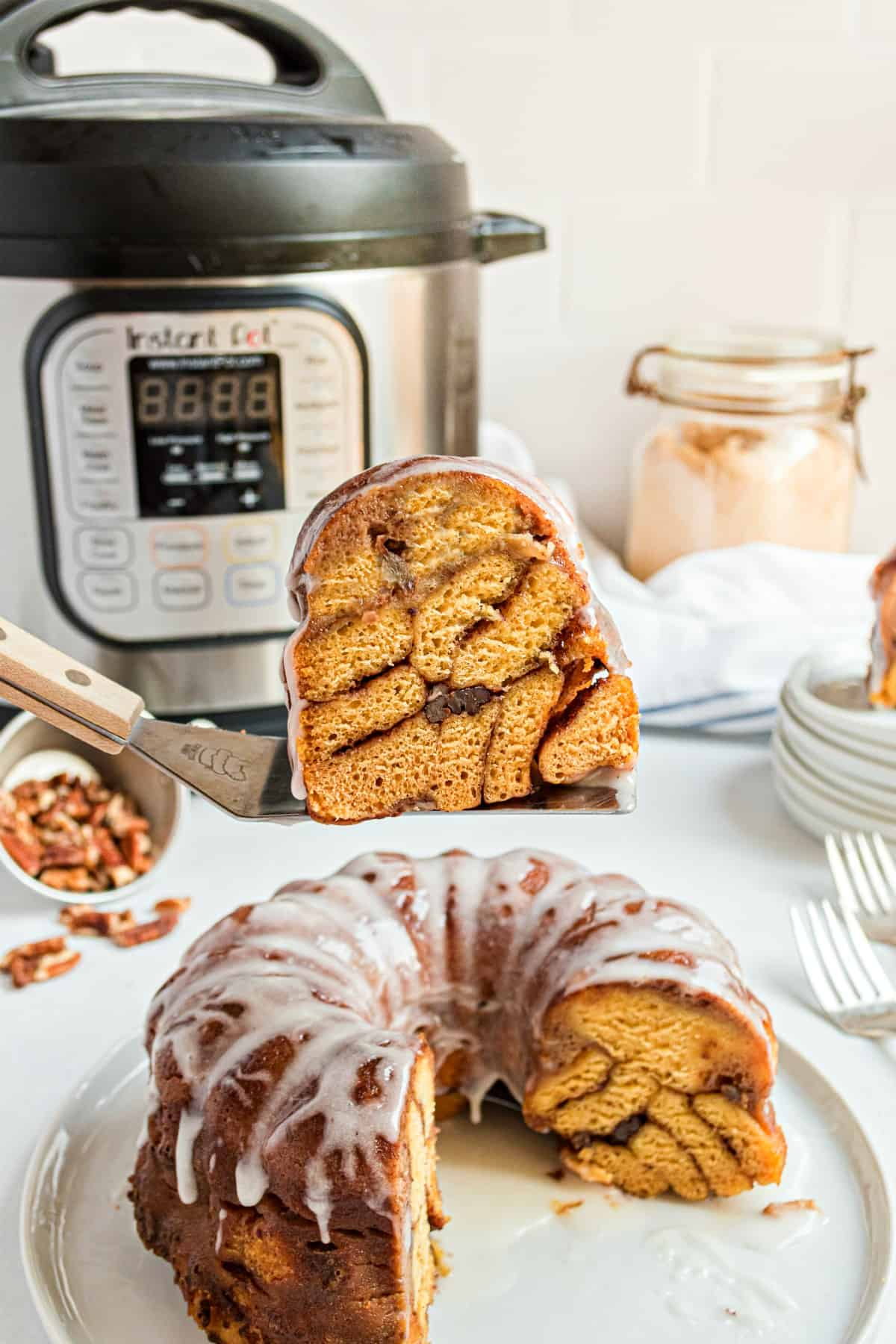 Thick slice of cinnamon roll bread revealing the layers of cinnamon pecans and rolls.