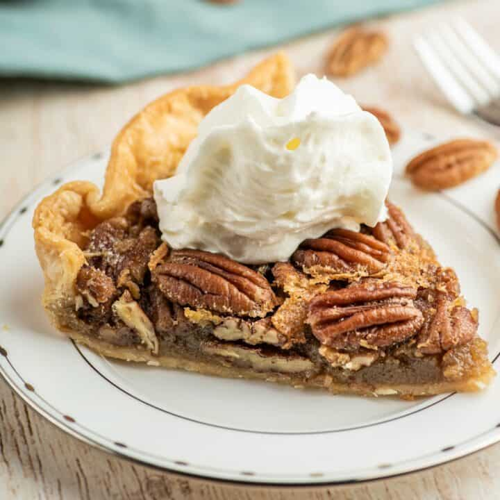 Pecan pie with whipped cream on top.
