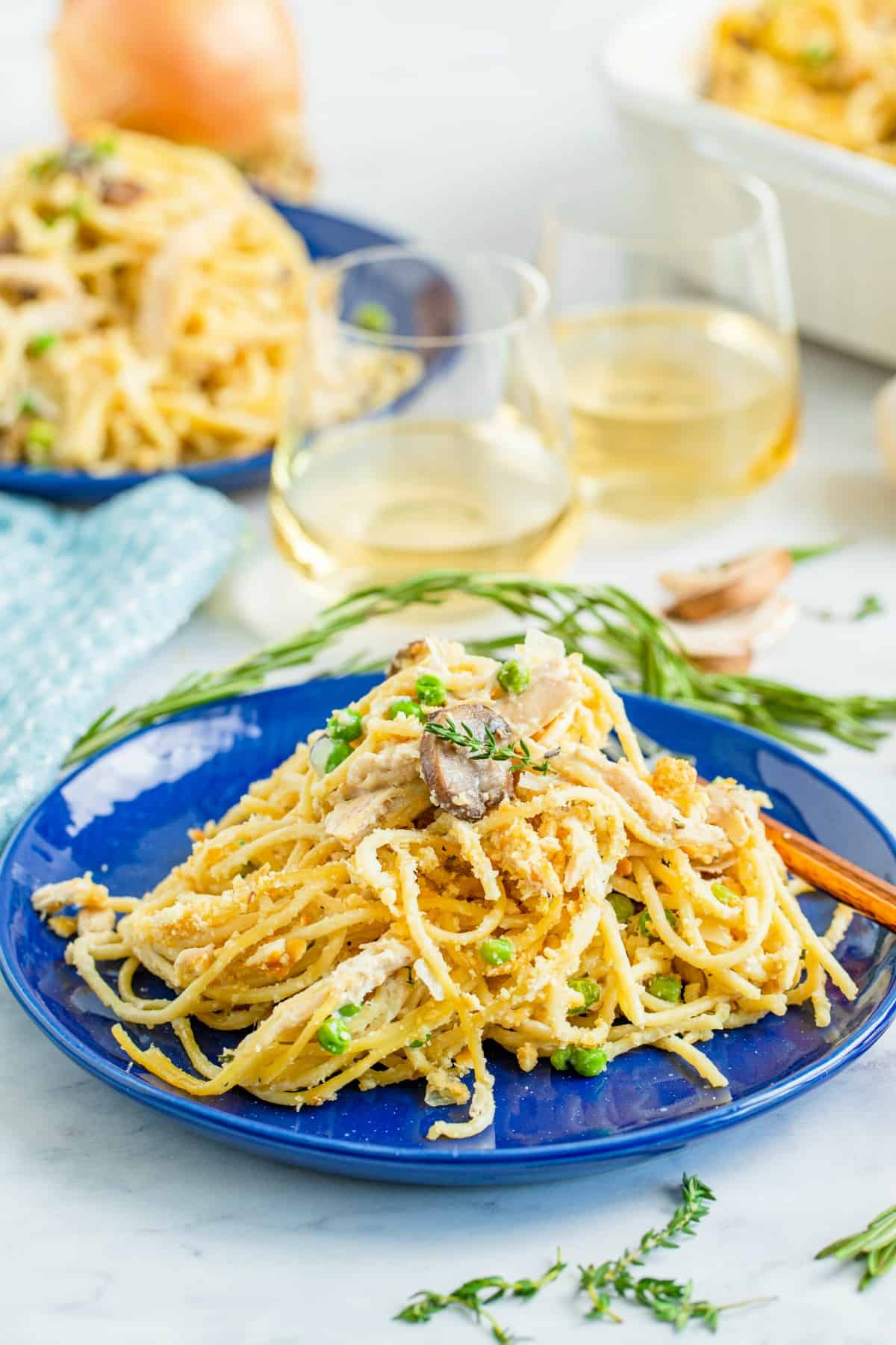 Turkey tetrazzini served on blue dinner plates.