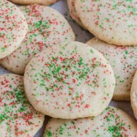 Stack of jingle cookies on parchment paper.