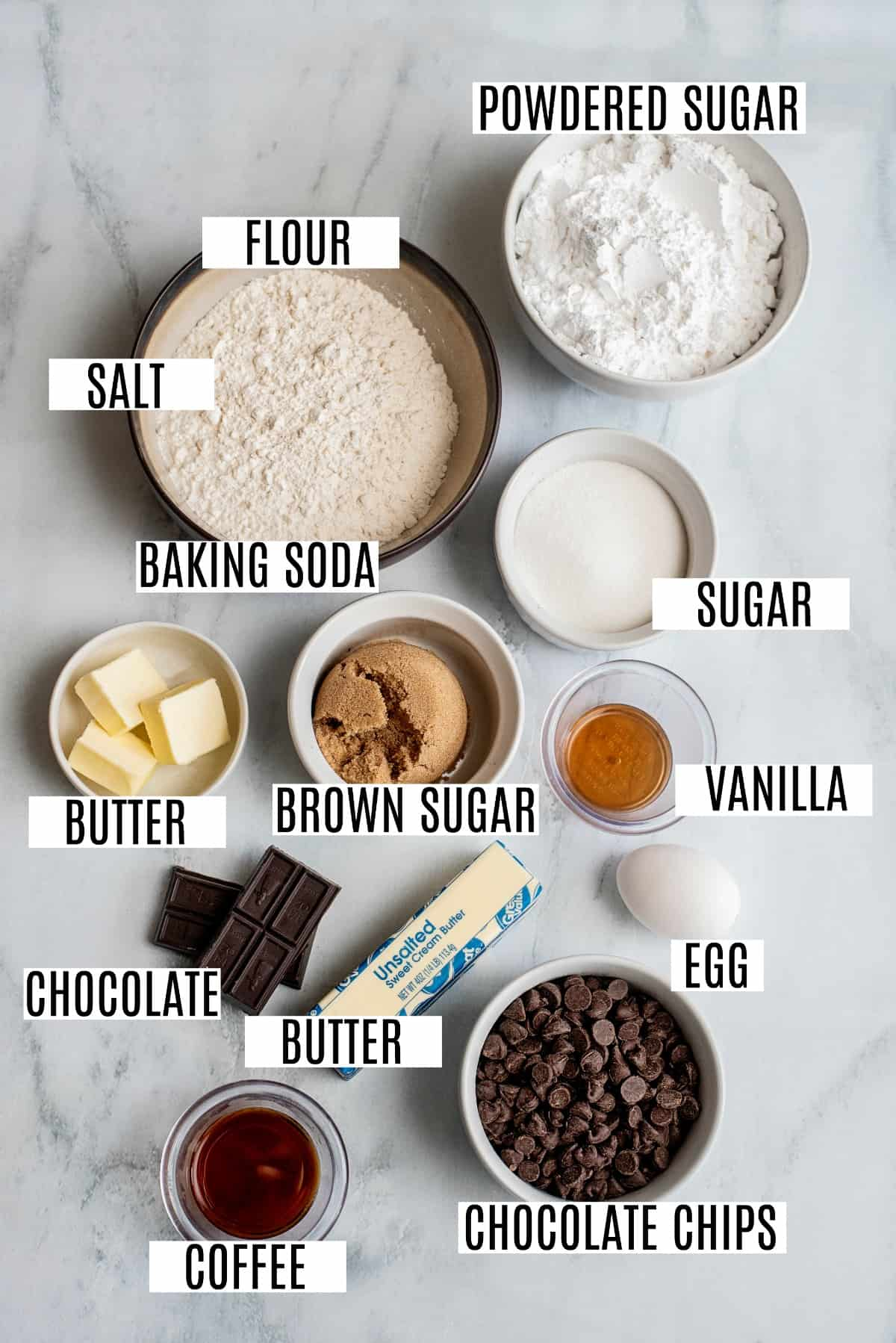 Ingredients needed to make chocolate chip sandwich cookies, including chocolate chips and butter.