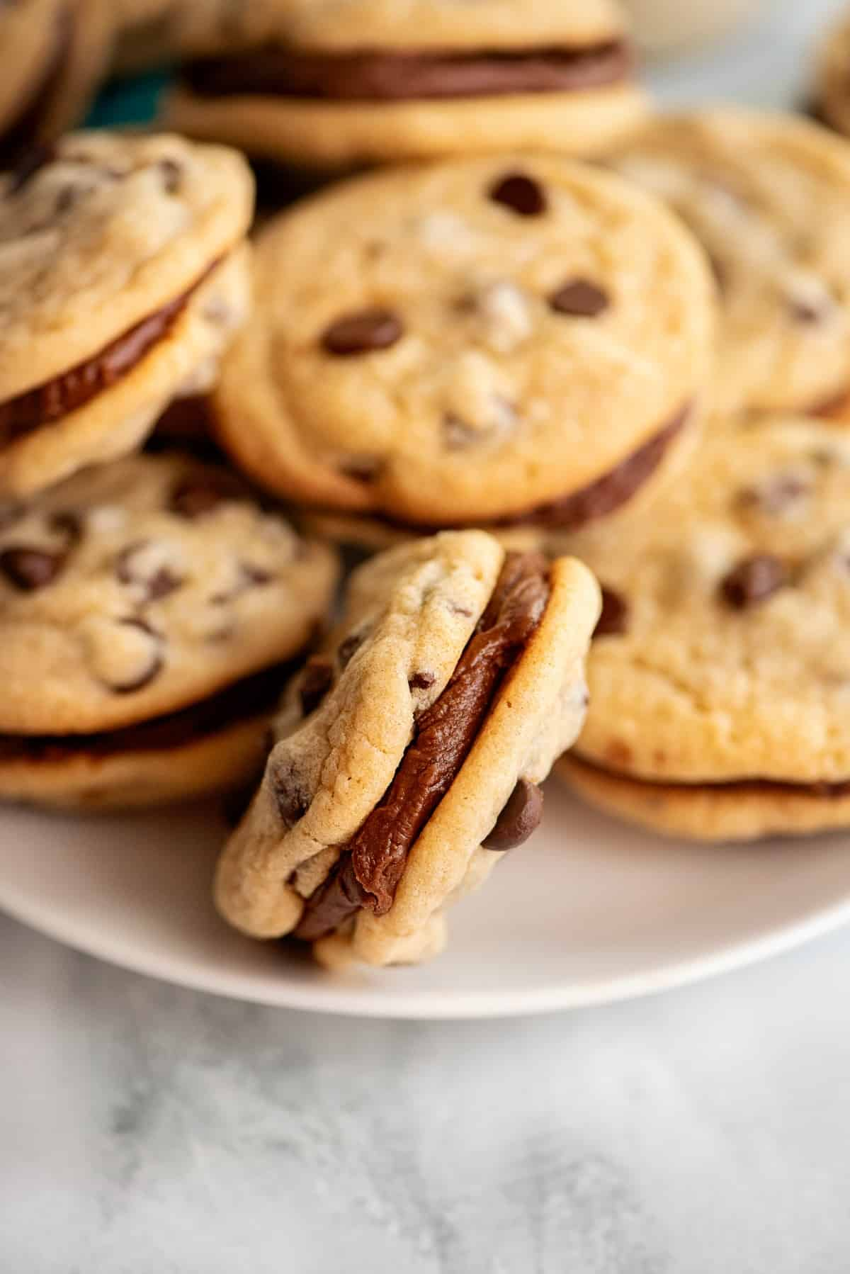 Chocolate chip sandwich cookies with fudge filling.