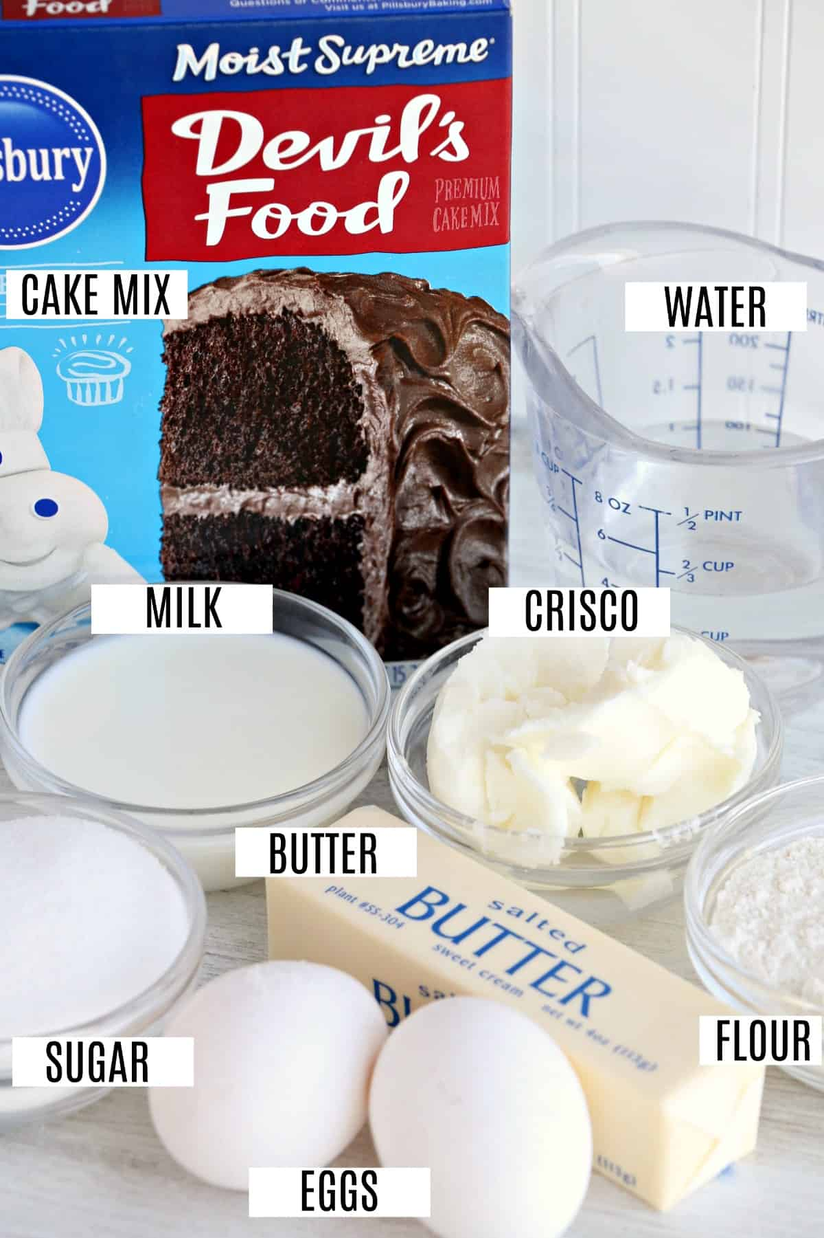 Ingredients to make chocolate whoopie pies including boxed cake mix.