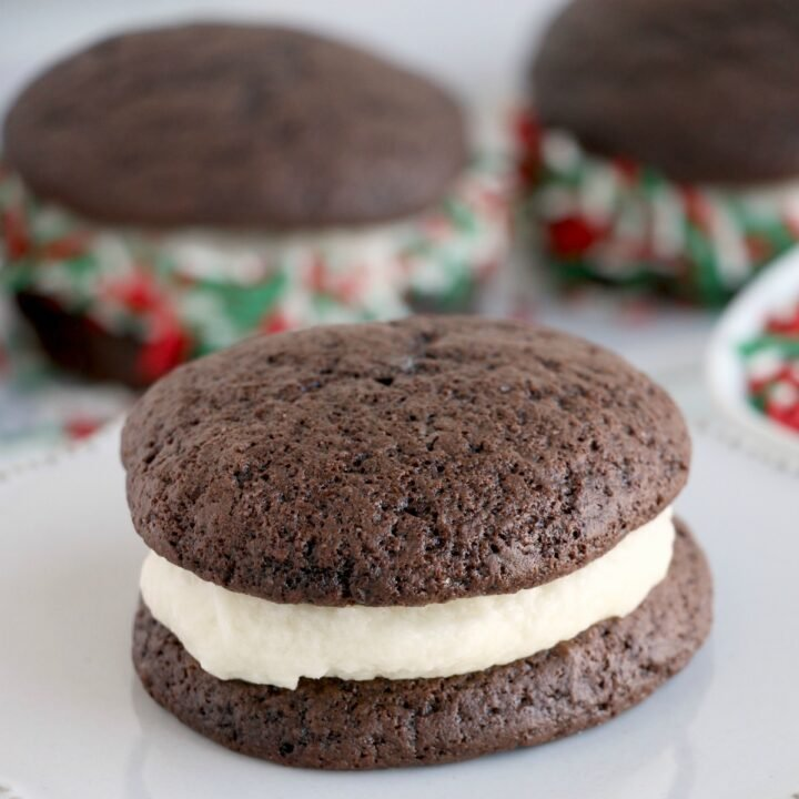 Bake up a batch of these easy Chocolate Whoopie Pies just in time for the holiday season. Soft chocolate cookies sandwiched together with a thick frosting filling and covered in sprinkles make a delicious addition to your cookie tray!
