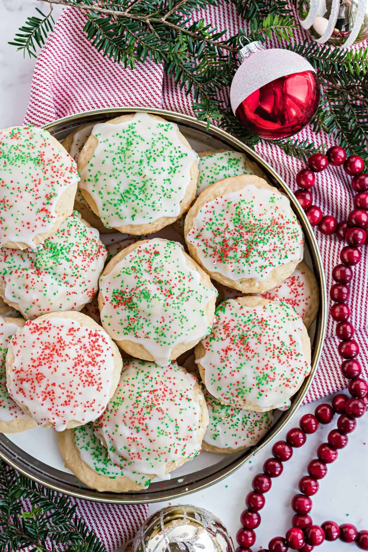 Ricotta cookies with Christmas sprinkles in tin.