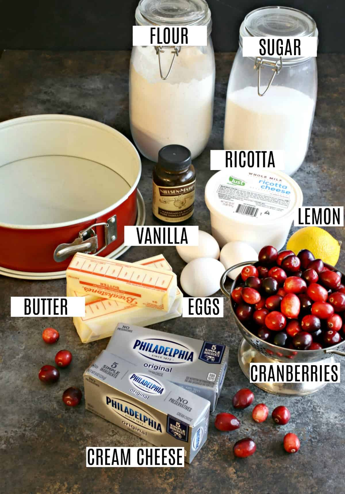 Ingredients needed to make cranberry cheesecake including ricotta and cream cheese.