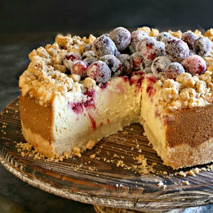 Cranberry Cheesecake with a delicious shortbread cookie crust and crumble and fresh cranberry swirl is a delightful holiday dessert! Topped with more sugared cranberries, this cheesecake looks as good as it tastes.