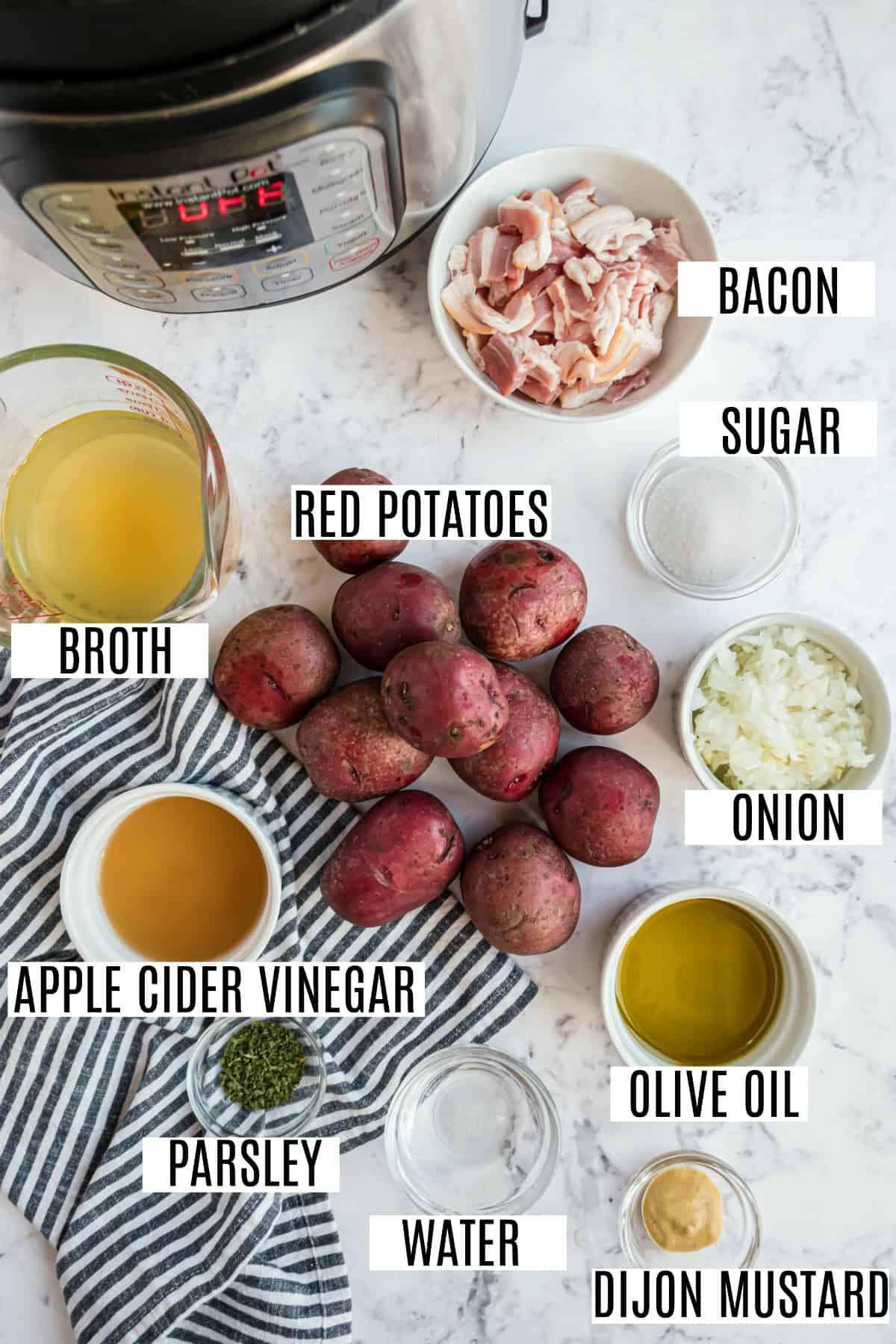 German potato salad ingredients including red potatoes, vinegar, and dijon mustard.