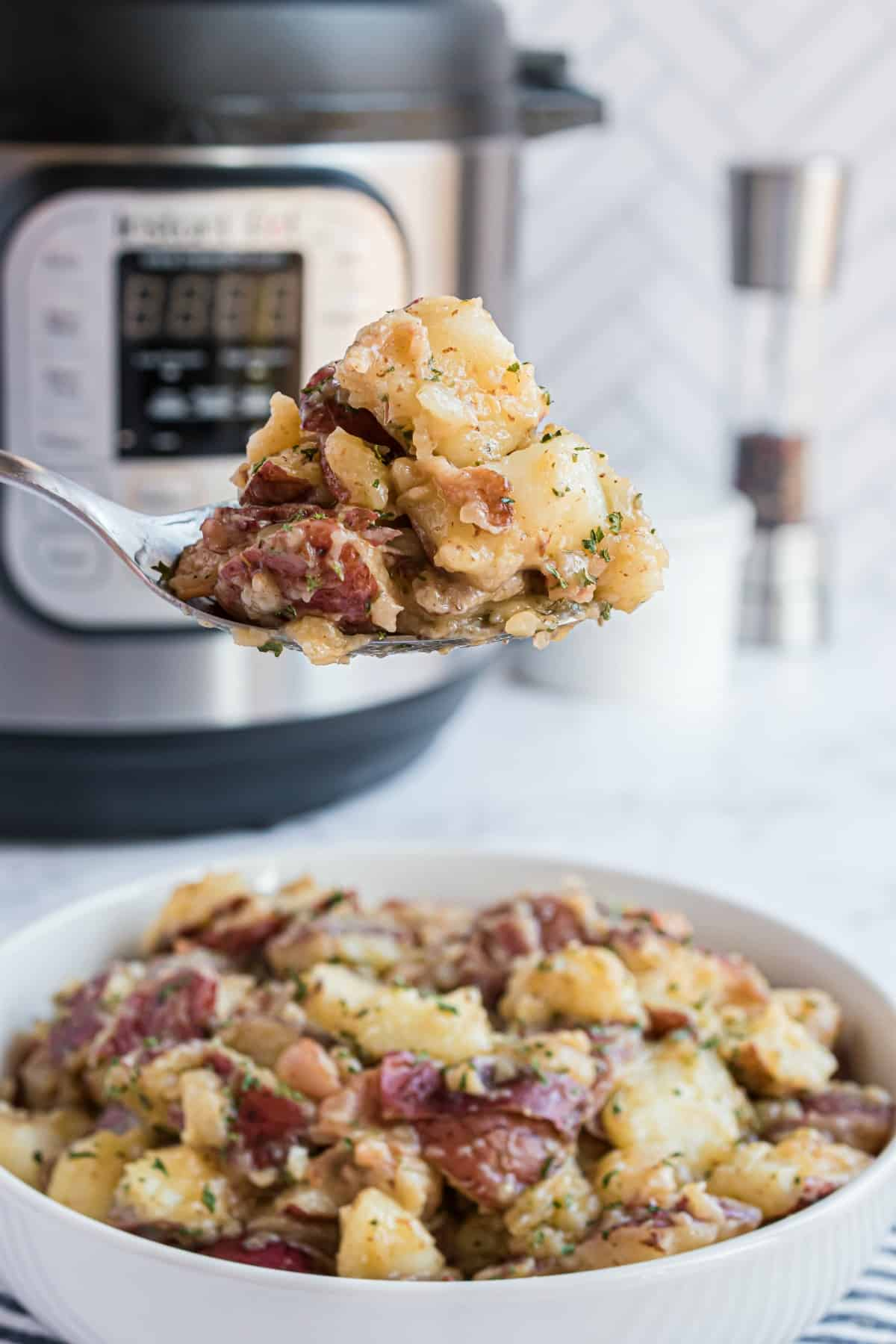 German potato salad with instant pot in background.