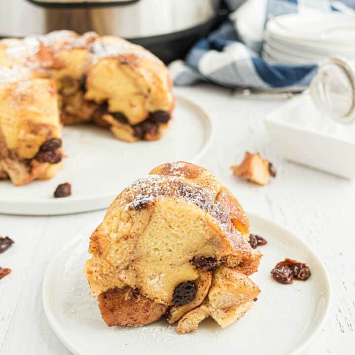 Learn to make Bread Pudding in the instant pot! Sweet bites of bread spiced with cinnamon and nutmeg and flecked with raisins, this dessert is simple, comforting and oh-so-delicious.