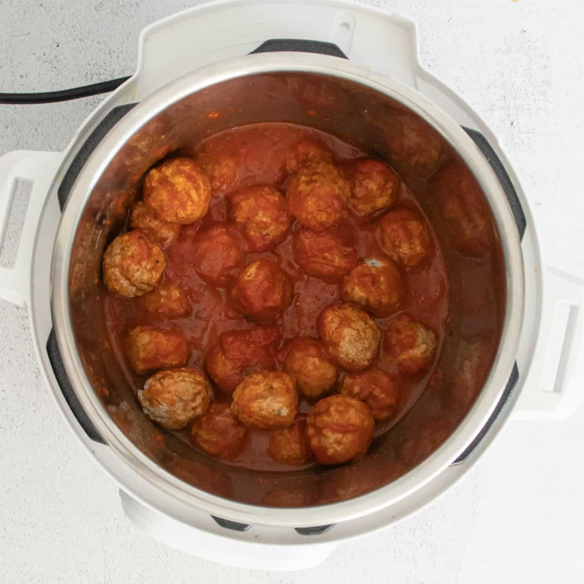 Meatballs in Instant Pot with marinara sauce.