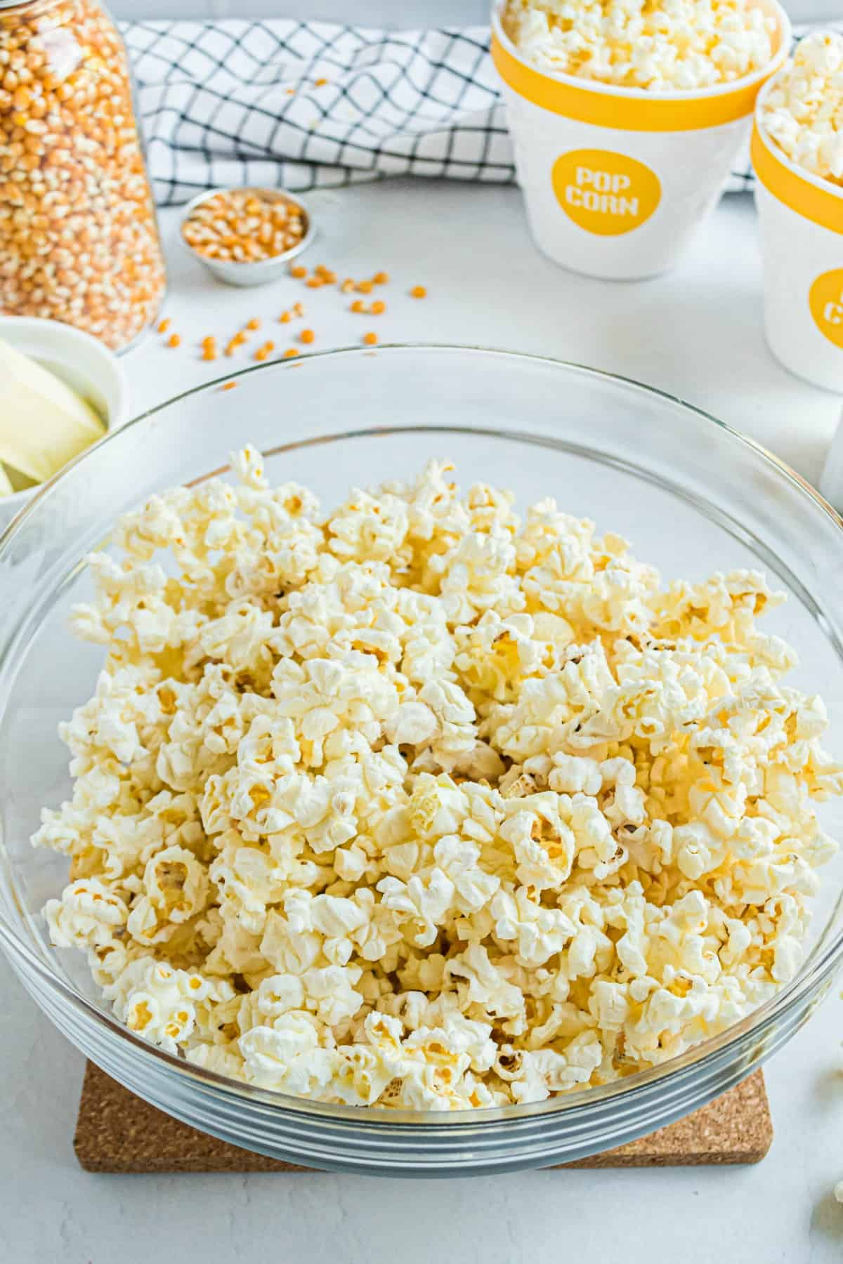 Clear glass bowl with microwave popcorn inside.
