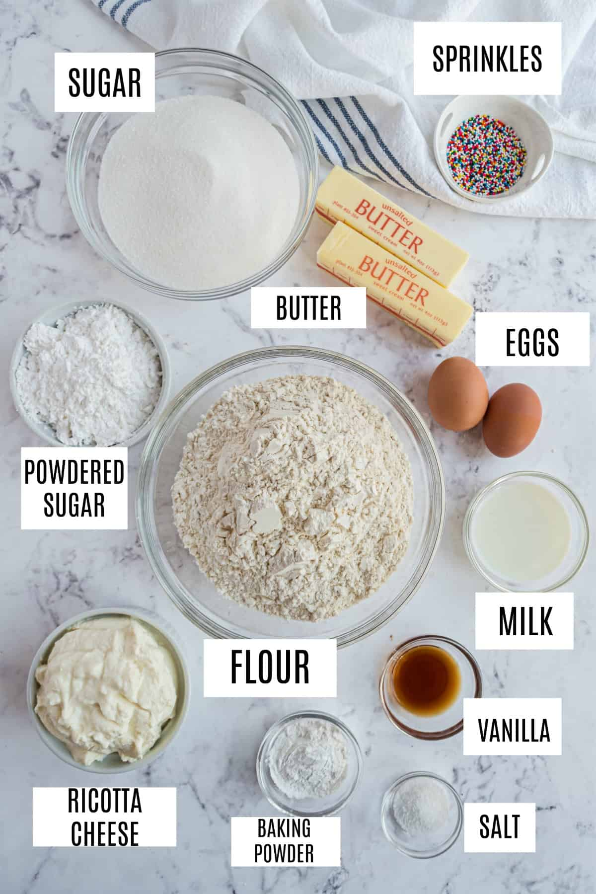Ingredients needed for ricotta cookies, including butter, eggs, and ricotta cheese.