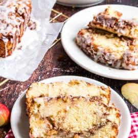 Apple cinnamon bread slices served on white plates.