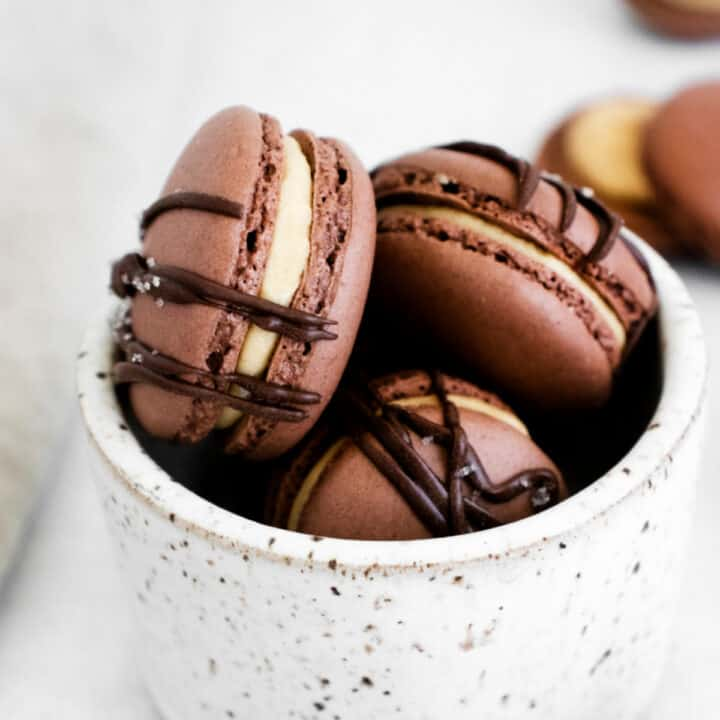 The delicate French meringue cookie made even more indulgent with the addition of chocolate. Chocolate Macarons spread with peanut butter buttercream are a little bite of Parisian heaven!